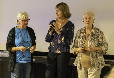 "Kelly presents Donna (left) and Dorothy (right) with the ""Above and Beyond Award"""